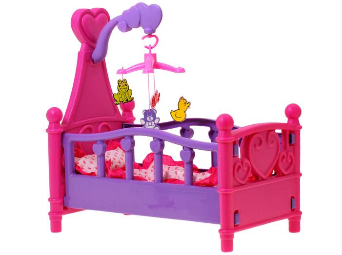 Postieľka pre bábiky s kolotočom