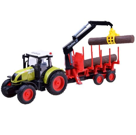 Detský traktor s vlečkou a kmeňmi stromov